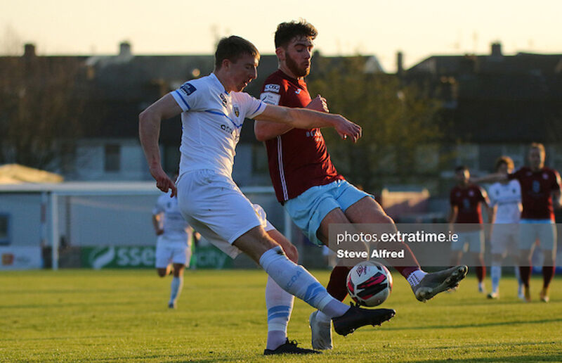 Sam Todd of UCD with Conor Drinan of Cobh Ramblers.