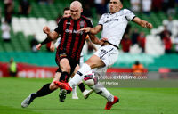Georgie Kelly challenges Giannis Michailidis for the ball at the Aviva Stadium on Tuesday, 3 August 2021.