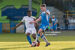 Mark Russell of Finn Harps controls the ball against Oluwatunmise Sobowale of Waterford.