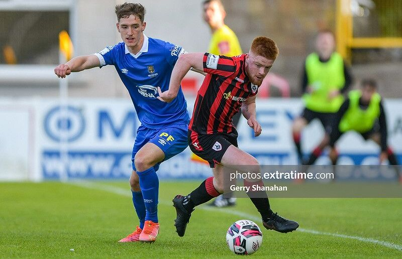 Longford Town FC's AODH DERVIN and Waterford FC's John Martin, tussle for the ball.