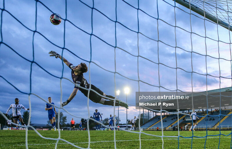 Paul Martin of Waterford fails to stop Michael Duffy of Dundalk scoring his sides third goal.