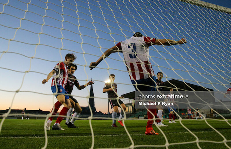 Marc Ludden of Treaty United clears a ball off the line.