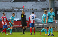 Charlie Fleming receives a red card from referee Declan Toland