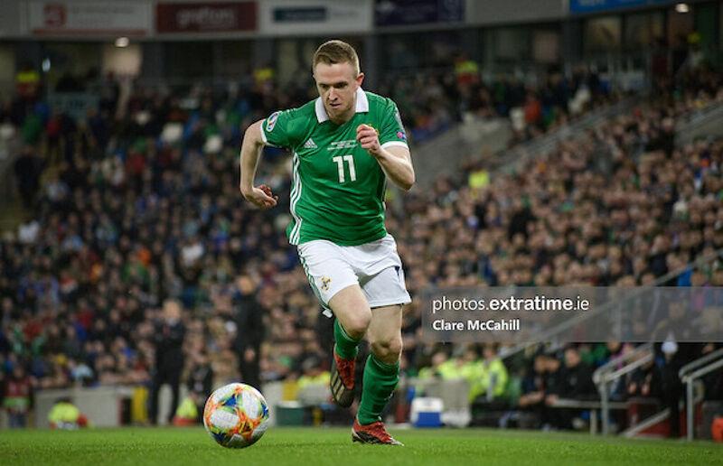 Shane Ferguson in action for Northern Ireland against Estonia in 2019