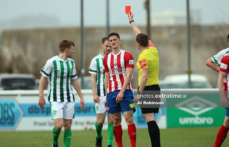 Sean McSweeney receives a red card from referee Oliver Moran