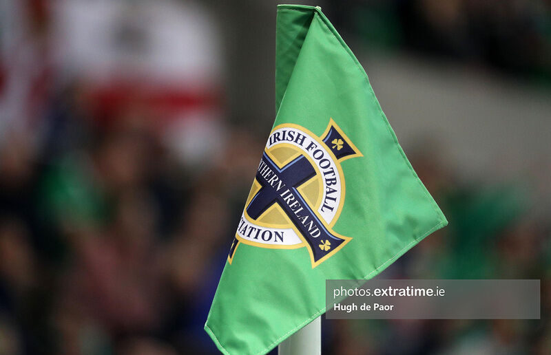 A corner flag emblazoned with the Northern Ireland logo.