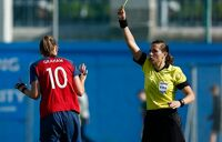 Referee Stéphanie Frappart hands out a yellow card to Norway's Caroline Graham Hansen during their 2-0 World Cup qualifying win over the Republic of Ireland in 2018.