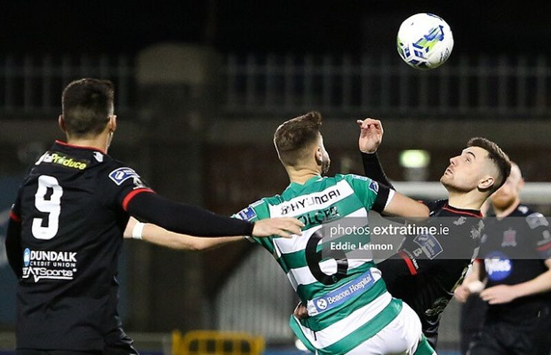 Flores in action for Dundalk against Shamrock Rovers in February.