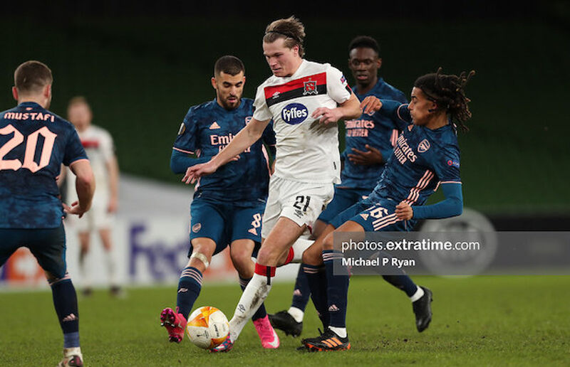 Daniel Cleary of Dundalk in action against Dani Ceballos and Miguel Azeez of Arsenal
