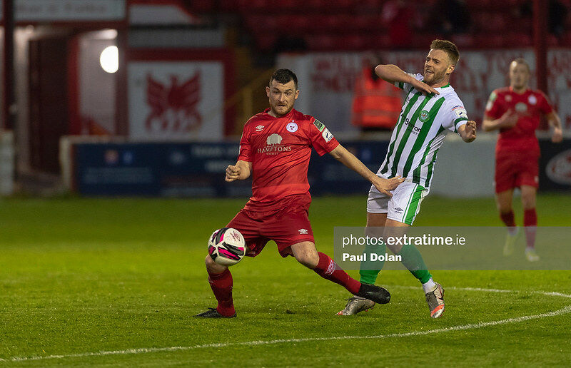 Ryan Brennan of Shelbourne FC holds off Conor Clifford of Bray Wanderers