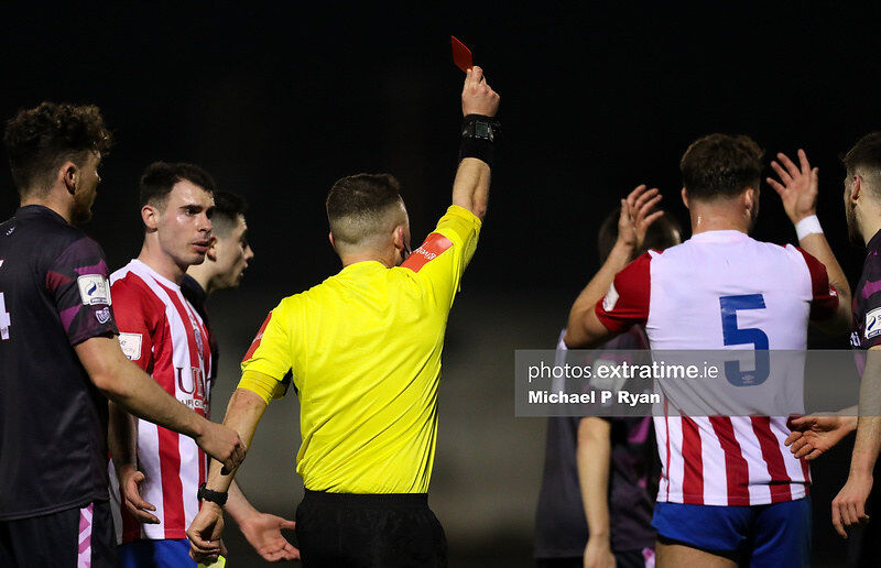 Clyde O'Connell of Treaty United, right, receives a red card from referee Jason Mannix.