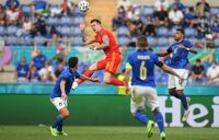 Joe Rodon of Wales wins a header whilst under pressure from Matteo Pessina and Emerson of Italy during the UEFA Euro 2020 Championship Group A match between Italy and Wales at Olimpico Stadium on June 20, 2021 in Rome, Italy.