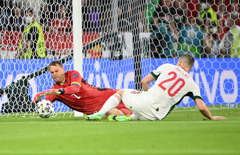Roland Sallai of Hungary stretches for the ball whilst under pressure from Manuel Neuer of Germany during the UEFA Euro 2020 Championship Group F match between Germany and Hungary at Allianz Arena on June 23, 2021 in Munich, Germany.