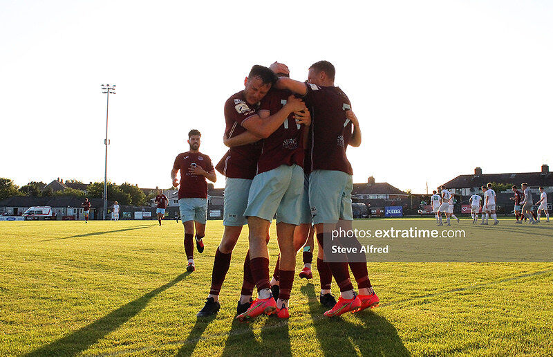 Conor Drinan of Cobh Ramblers and teammates celebrates after scoring the side's first goal.