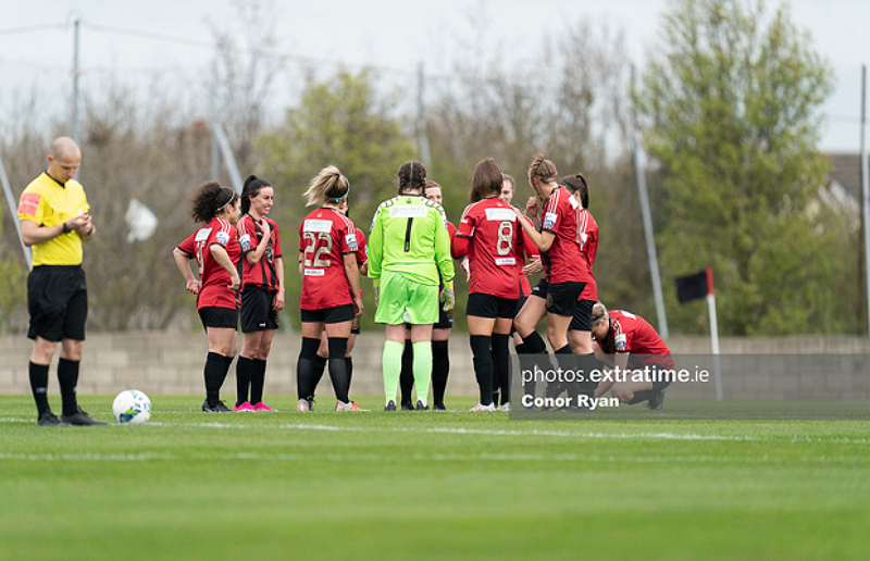 Bohemians players huddle together before their 6-2 win over Treaty United on Saturday, March 27 2021.