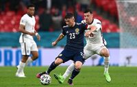 Billy Gilmour of Scotland is closed down by Mason Mount of England during the UEFA Euro 2020 Championship Group D match between England and Scotland at Wembley Stadium on June 18, 2021 in London, England