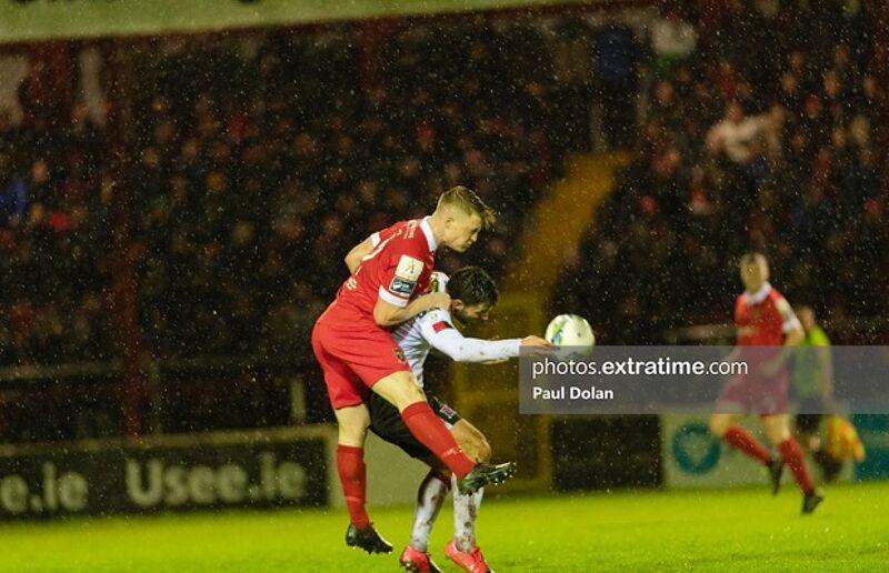 Daniel O'Reilly Shelbourne FC outjumps Patrick Hoban Dundalk FC