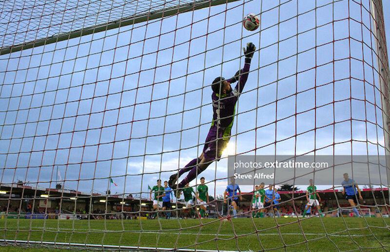 Mark McNulty of Cork City is beaten by Jack Keaney's free kick.