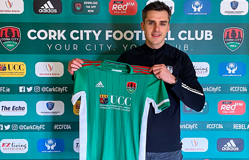 Jack Walsh poses with the Cork City jersey after signing on for the 2021 season.